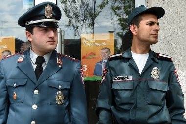 Policemen brought out mayoral candidate Zaruhi Postanjyan from the election headquarters of Taron Margaryan during the city council elections in Yerevan, Armenia - Photolure News Agency