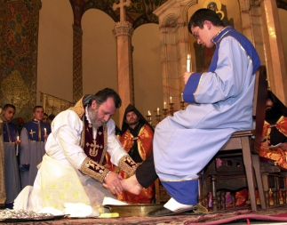 His Holiness Karekin II, the Catholicos of all Armenians washes the feet of one of his 12 disciples during the Maundy Thursday, March 28, 2002 ceremony at Holy Etchmiadzin in Yerevan, Armenia - Photolure News Agency