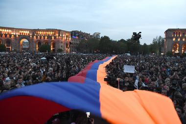 Armenian flag above the activists of '#merjirserjin' initiative during the protest rally against former Armenian president Serzh Sargsyan to the post of Prime Minister on the Republic Square of Yerevan, Armenia - Photolure News Agency