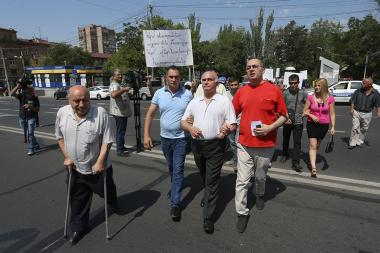 People with visual impairments hold a protest action near the statue of Avetik Isahakyan in Yerevan, Armenia - Photolure News Agency