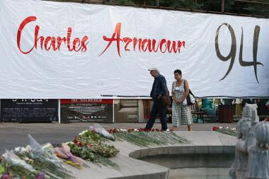People lay flowers and Candle-lighting after hearing the news of Charles Aznavour death on the square named after Charles Aznavour in Yerevan, Armenia - Photolure News Agency