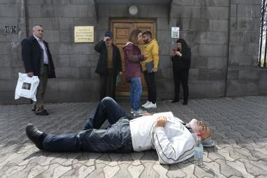 Vartgez Gaspari holds a protest action laying near the entrance of the RA National Assembly building - Photolure News Agency