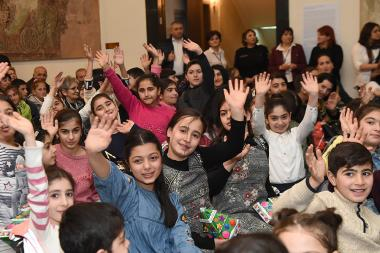 A New Year festive event was organized for the disabled, socially insecure and freedom fighters' children at the RA National Gallery - Photolure News Agency