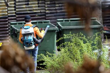 A man disinfects garbage cans in order to prevent the spread of coronavirus (COVID-19) in Armenia - Photolure News Agency