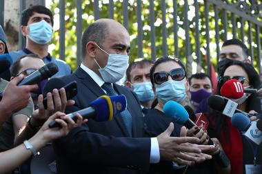 People hold a protest action demanding RA Minister of Education, Science, Culture and Sport Arayik Harutyunyan's resignation in front of the RA National Assembly building - Photolure News Agency