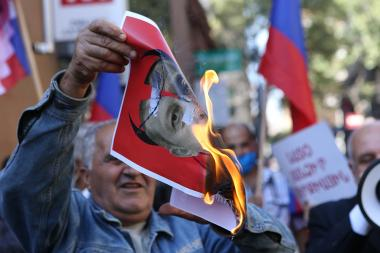 People hold a protest action under the slogan of 'No to Genocide' in front of the NATO Information Center in Armenia - Photolure News Agency