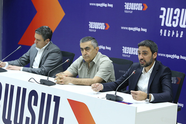 Official representative of the central headquarters of the 'Armenia' Alliance Aram Vardevanyan and members of the Alliance Armen Rustamyan and Artur Ghazinyan hold a briefing at the headquarters of the 'Armenia' Alliance - Photolure News Agency