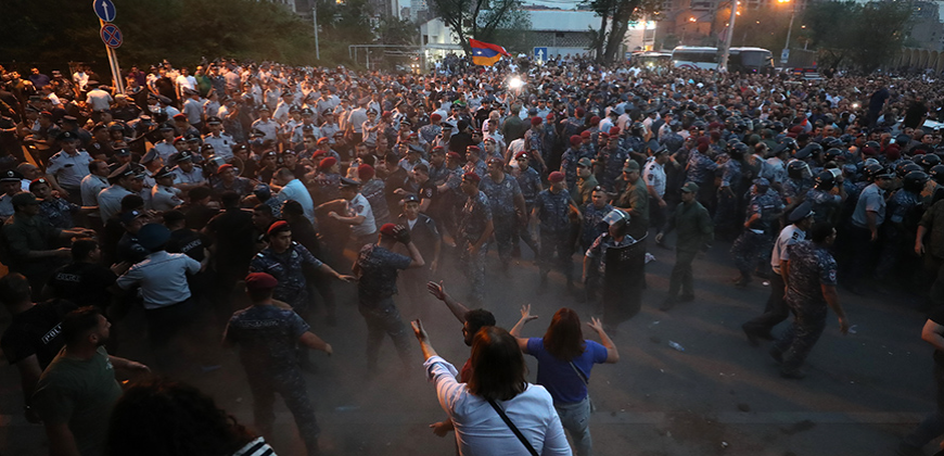 A man holds a protest action nailing his feet on the ground of the Republic Square of Yerevan, Armenia