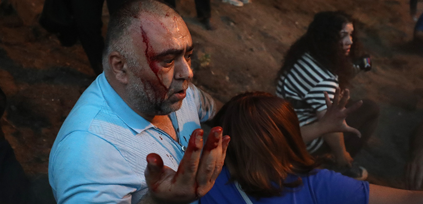 Participants of the torchlight procession heading to the Armenian Genocide Memorial Complex burnt the Turkish and Azerbaijani flags on Freedom Square of Yerevan, Armen